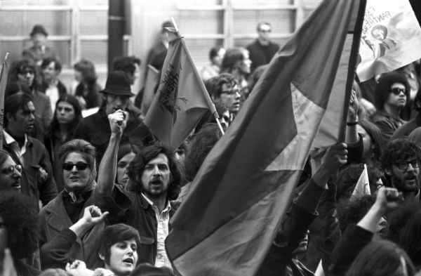 Kent State shootings demonstration: Shouting demonstrators & Vietcong flag, State House, Boston Common
