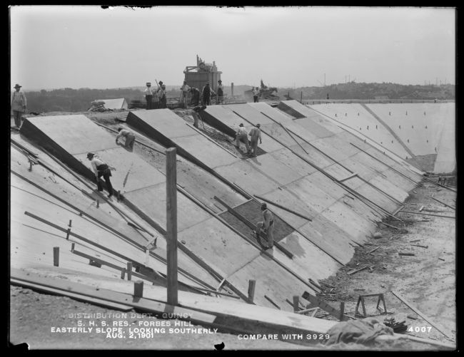 Distribution Department, Southern High Service Forbes Hill Reservoir, building the easterly slope, looking southerly (compare with No. 3929), Quincy, Mass., Aug. 2, 1901