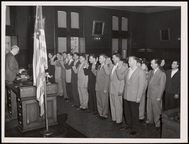 28 Cambridge police officers sworn in at Camb. City Hall this morning by city clerk Fred Burke