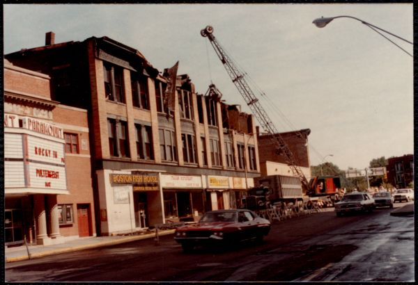 Demolition crane, Paramount Movie Theatre, Newton Corner. Newton, MA