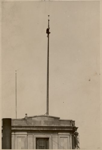 Boston City Hall - man on flagpole