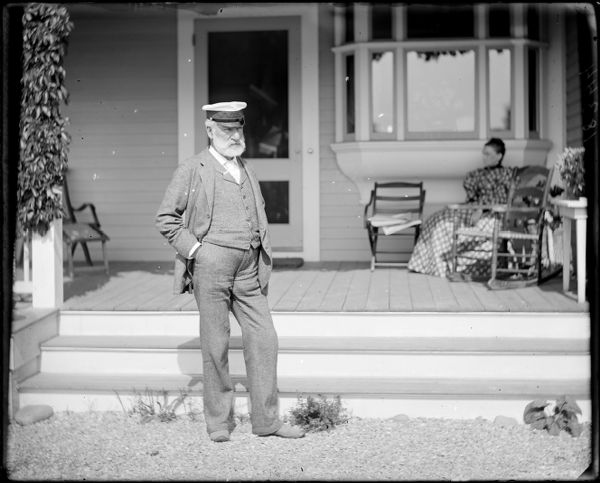 """Charles W. Parker at """"Redgate"""" with Mary Jane? in background, Marblehead, MA"""