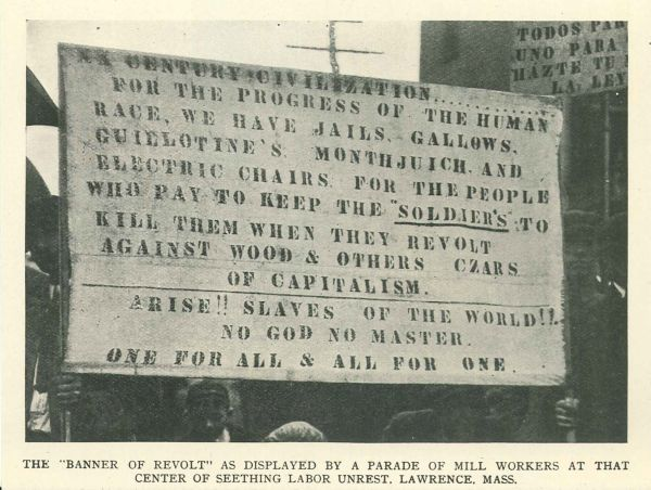"The ""banner of revolt"" as displayed by a parade of mill workers at that center of seething labor unrest, Lawrence, Mass."