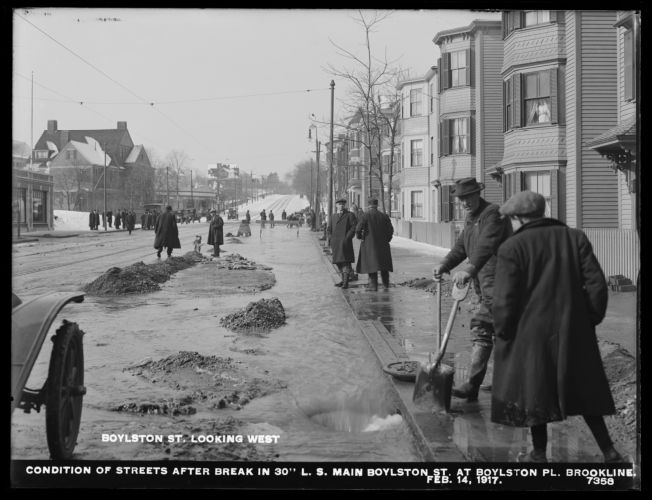 Distribution Department, Low Service Pipe Lines, condition of streets after break in 30-inch main, Boylston Street at Boylston Place, looking west, Brookline, Mass., Feb. 14, 1917