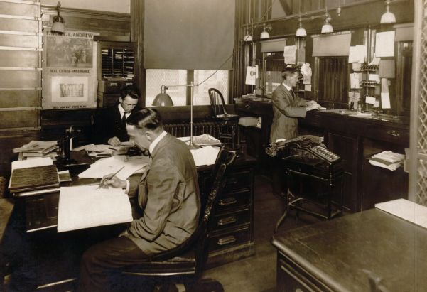 Three men working behind the windows at the Lawrence, Massachusetts Post Office