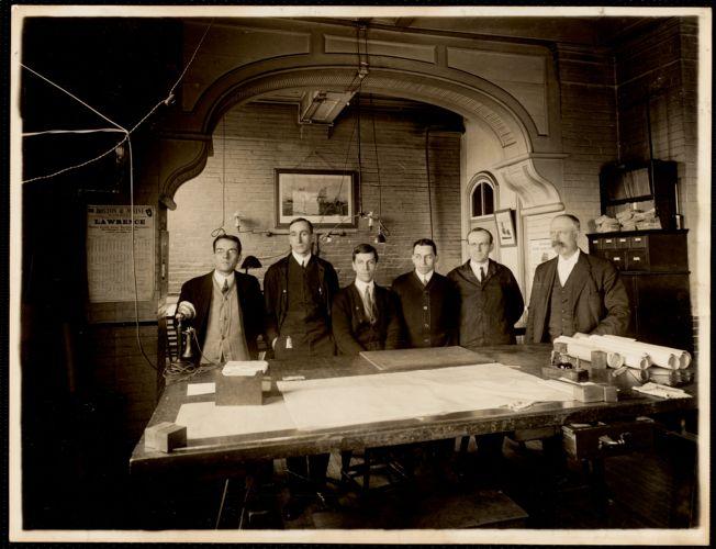 Group in drafting room, W. 6 mill. Reading from right to left - Mr. Schwarz, Hill, Benoit, Eichler, Perkins & Stevens