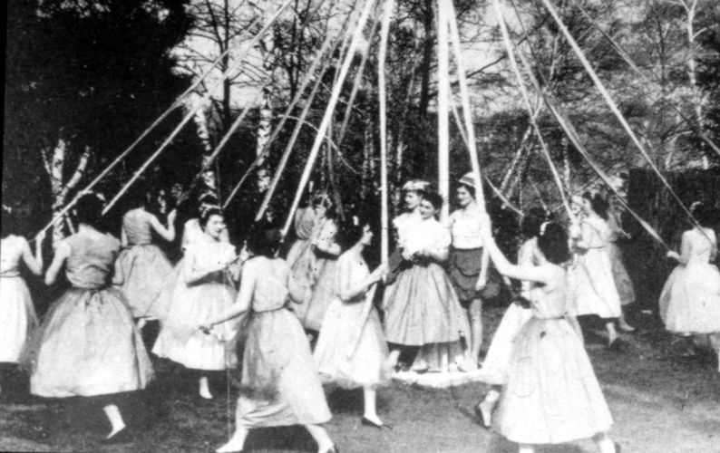 Class of 1958 celebrate May Day with the May Pole Dance, 1956