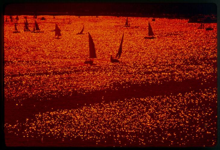 Afternoon sun and sailboats on Charles River Basin, Boston