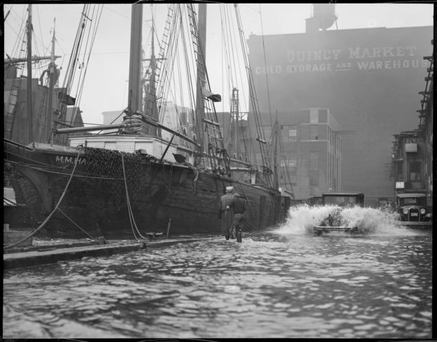 T-wharf flooded from storm, M.M. Hamilton docked, 2 masted wooden ship