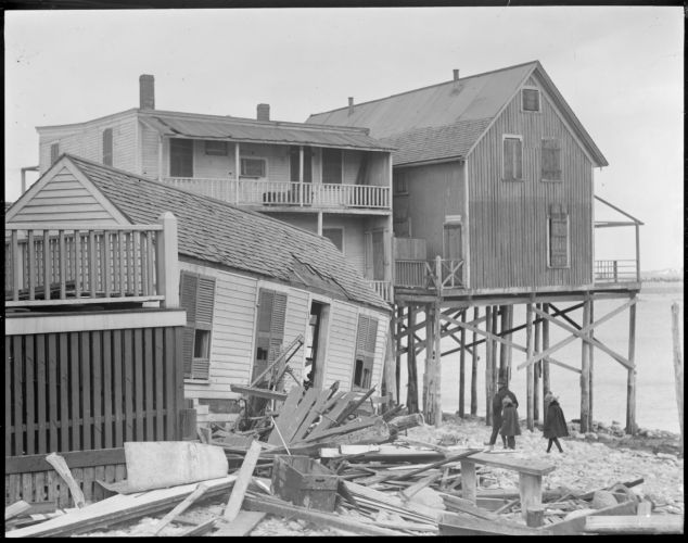 Storm damages houses on water
