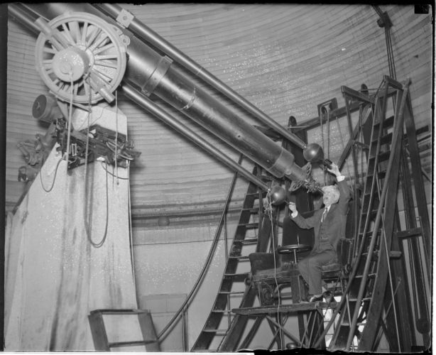 Man working at telescope in Cambridge observatory