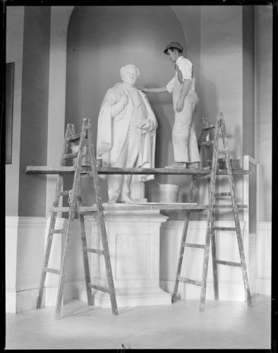 State House statue - John A. Andrew statue being cleaned up in State House by Robert J. Guthrie. Andrew was Gov. of Mass. way back in 1870