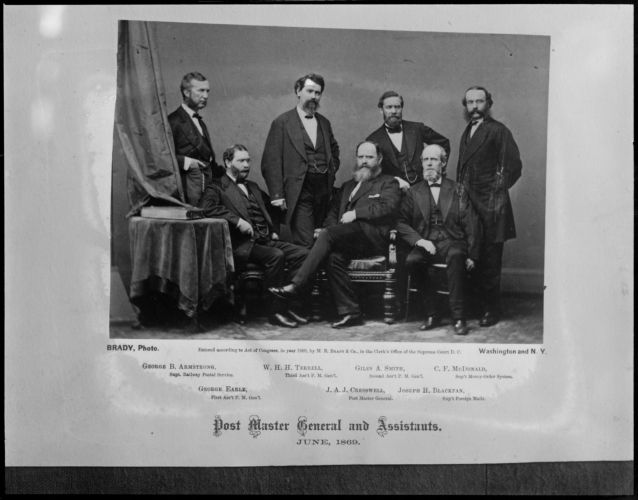 Brady photo of the Post Master General and assistants, June 1869, taken from cornerstone of old post office