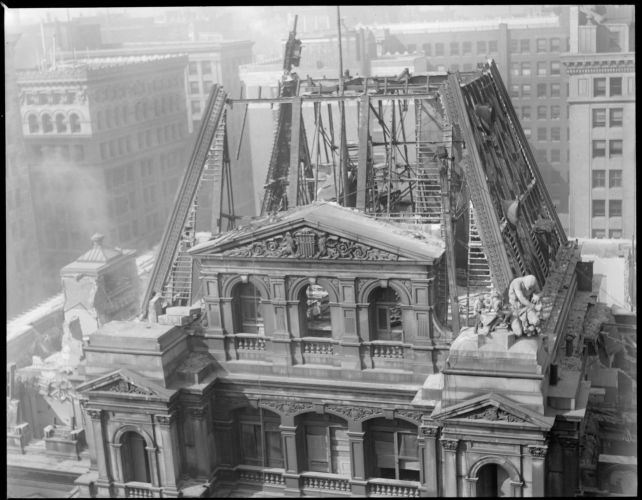 Famous old post office building being torn down, showing the last of French's statue being removed, Boston, Mass.