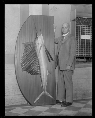 Dean Gleason L. Archer of the Suffolk law school with the big fish he caught off Miami