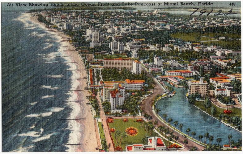 Air view showing hotels along ocean front and Lake Pancoast at Miami Beach, Florida