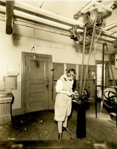 Female student working in the woodshop