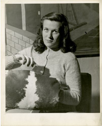 Woman with cowhide purse