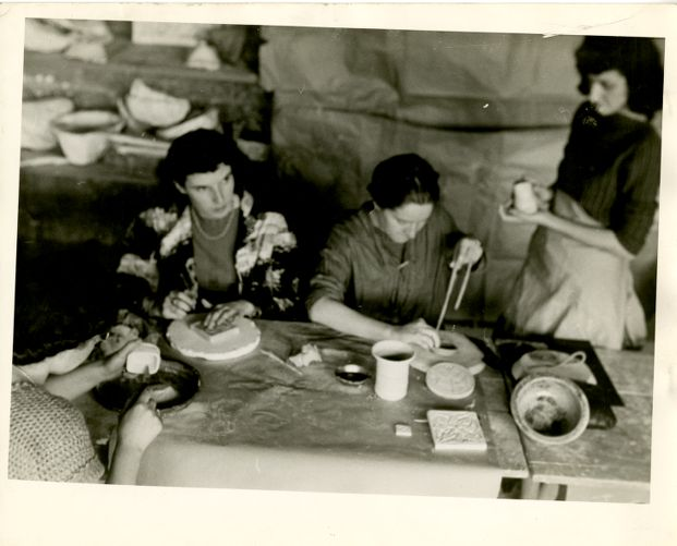 Students working in a ceramics studio