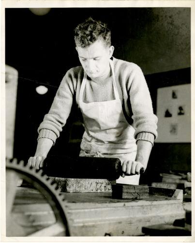 Student working in printmaking studio