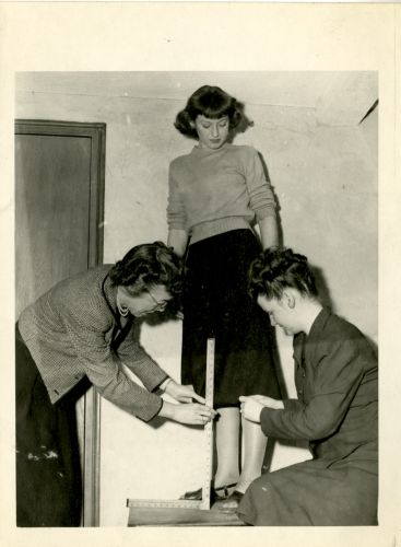 Students hemming a skirt