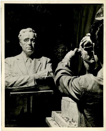 Student sculpting bust