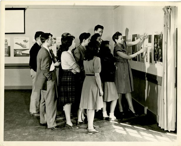 Students looking at posters