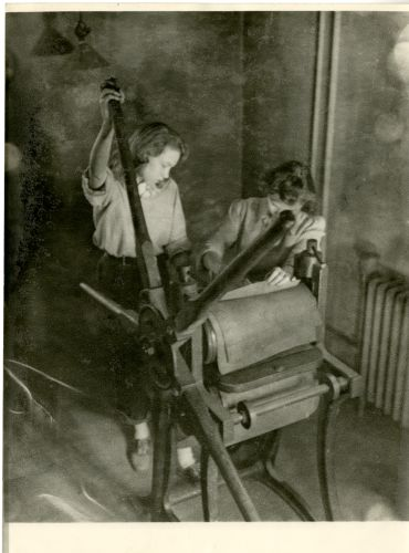 Students using printing press