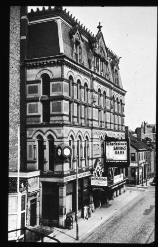 100th anniversary of Charlestown Savings Bank advertised on facade of Masonic Building in Thomson Square 1854-1954