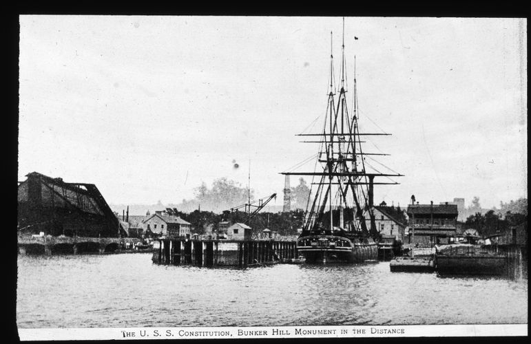 The U.S.S. Constitution, Bunker Hill Monument in the distance