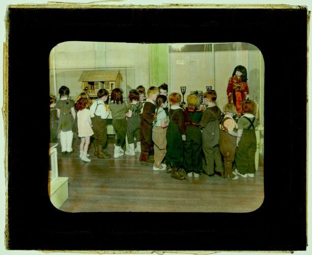 102 Little children in doll room