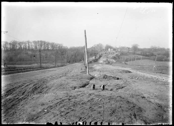 Changing road between Gates and H. M. Burt