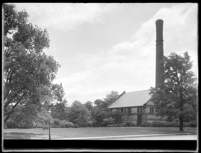 Distribution Department, Chestnut Hill Reservoir, work on English Elm trees along Beacon Street; looking towards Chestnut Hill High Service Pumping Station, Brighton, Mass., Nov. 1920-1921