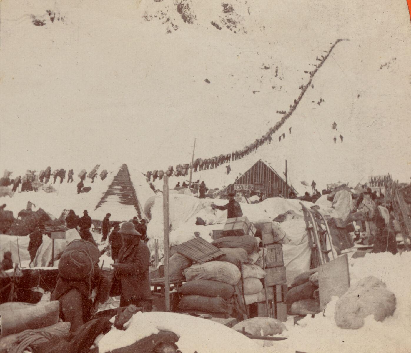 Prospectors bound for the Klondike gold fields, in Chilkoot Pass, Alaska, 1898. Digital Commonwealth.