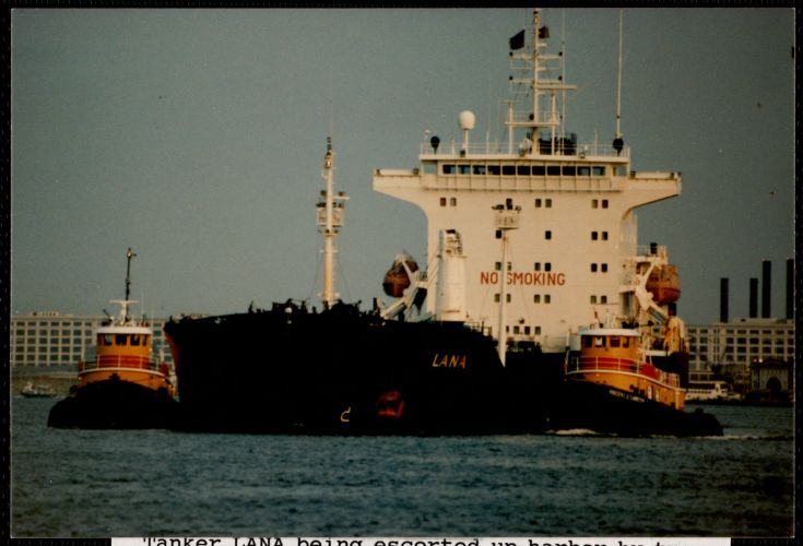 Tanker Lana being escorted up harbor by tugs
