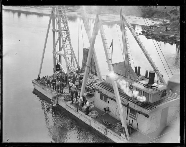 1. Pile driver no. 7 on water. 2. Diver 3. US Engineer Dept. work boat