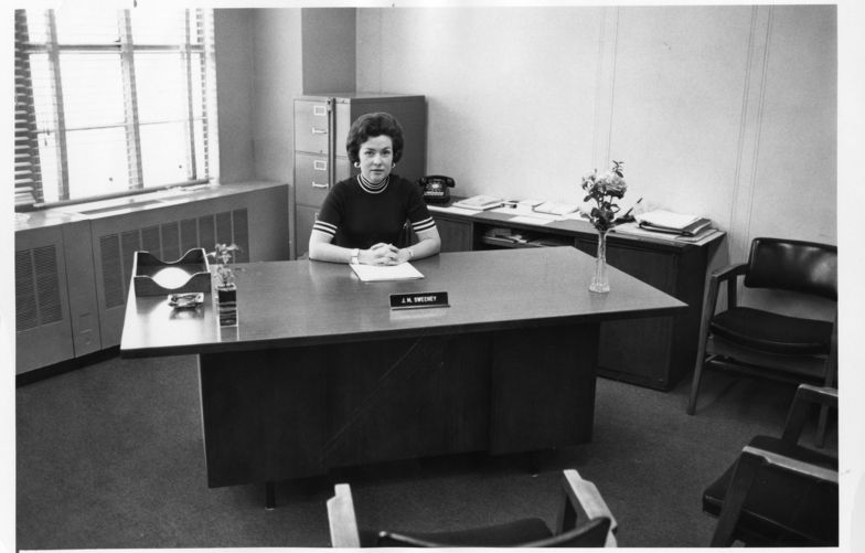 J.M. Sweeney at her desk in 1975