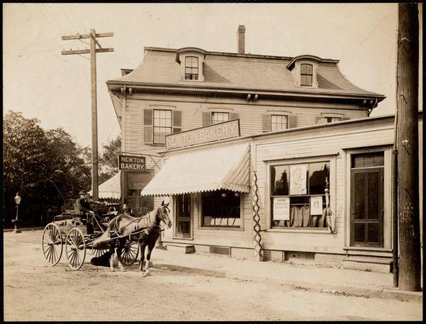 On Washington St. Newton bakery. Horse, carriage, policeman. Newton Corner, Newton, MA