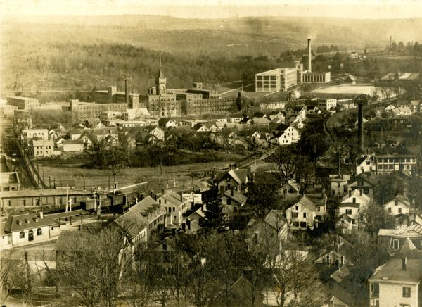 Aerial view of town of Southbridge, MA and the American Optical Company from Notre Dame Church during construction