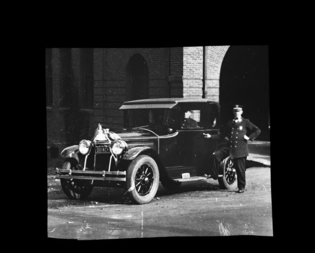 Acting Chief John Faircloth with Buick car