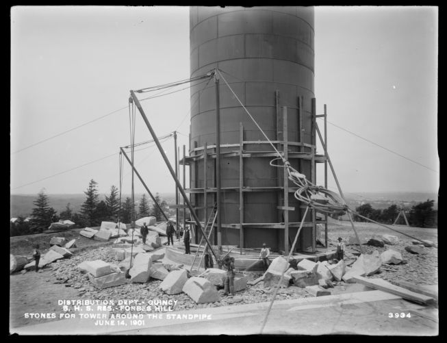Distribution Department, Southern High Service Forbes Hill Reservoir, building the stone tower around the Standpipe, Quincy, Mass., Jun. 14, 1901