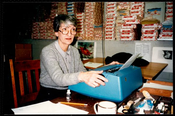 Newton Free Library, Newton, MA. Staff & trustees. Woman at typewriter - Social Services