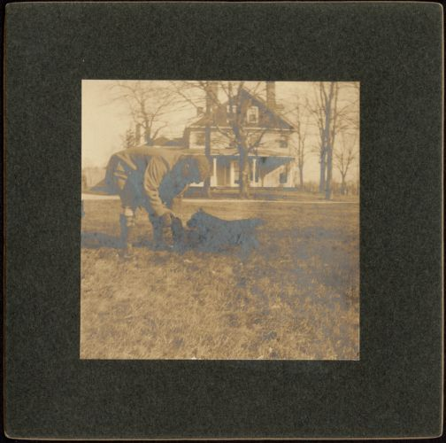 Ashdale Farm. Man with two dogs (terriers), possibly Otto Kunhardt.