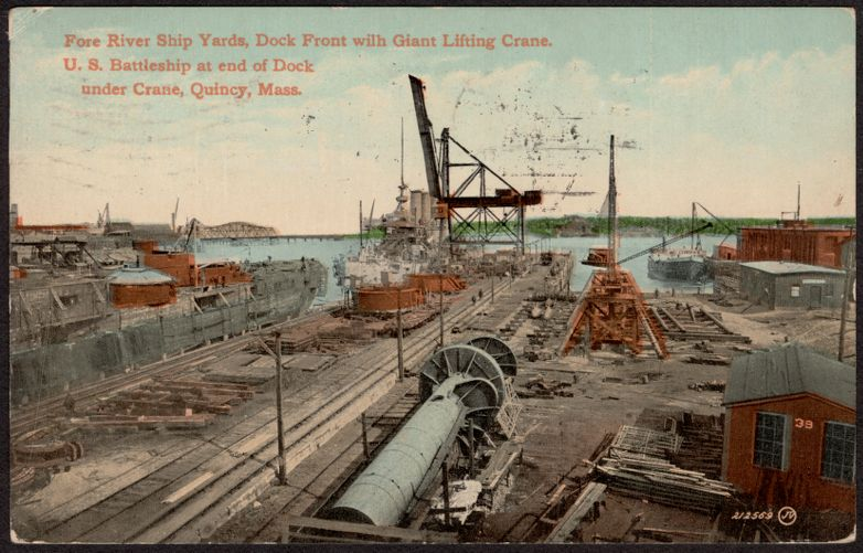 Fore River Ship Yards, dock front with giant lifting crane, U.S. battleship at end of dock under crane, Quincy, Mass.