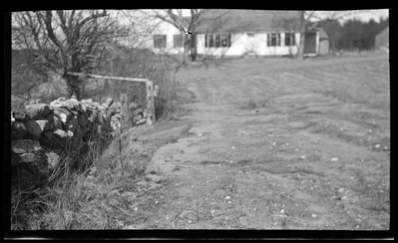 Unidentified yard and house