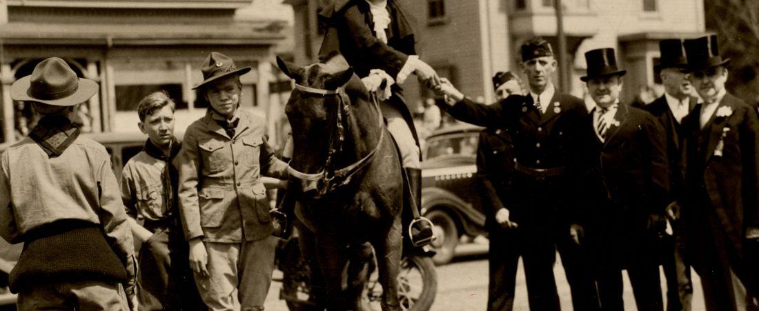 Patriots Day. Paul Revere reenactor greeting dignitaries
