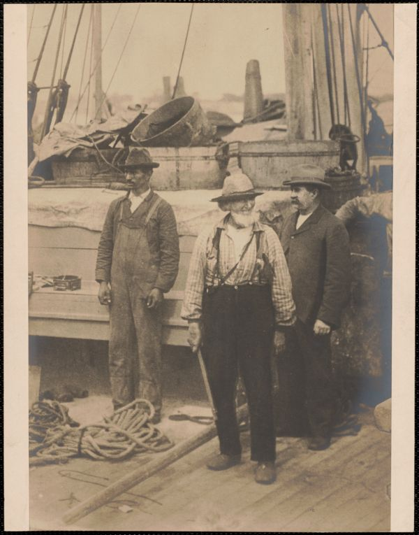 Frank Lewis and others on ship deck