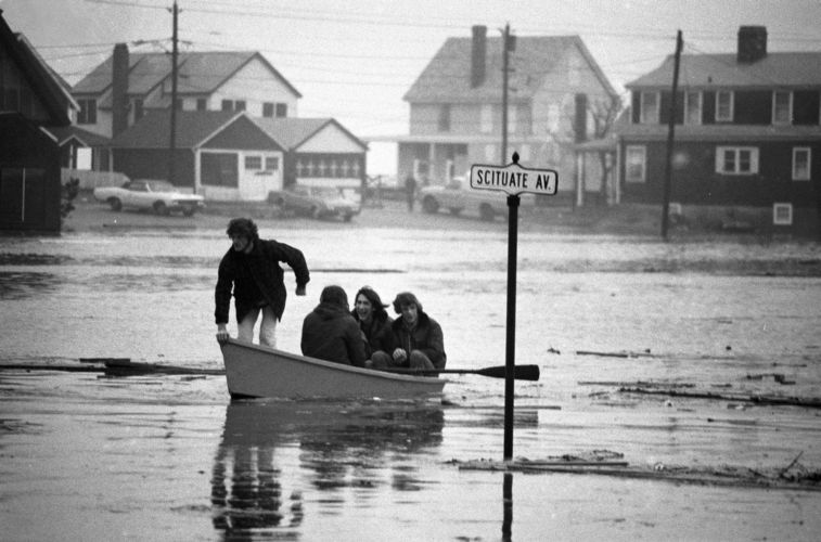 After flooding, locals travel streets by boat, Scituate