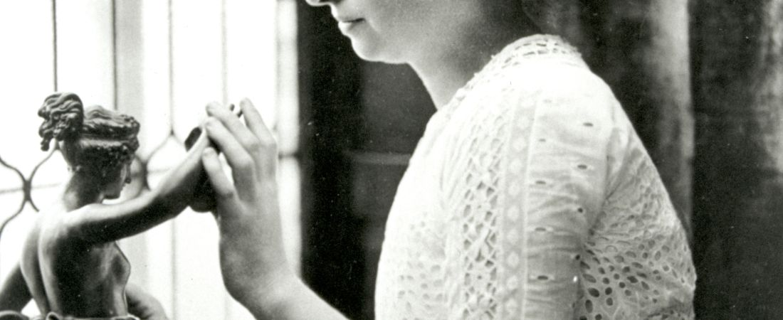 Helen Keller investigating statue