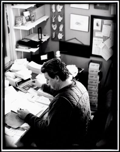 Eddie Hook calculating prices at desk